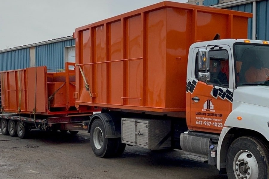 Image depicts rental disposal bins attached to a truck.