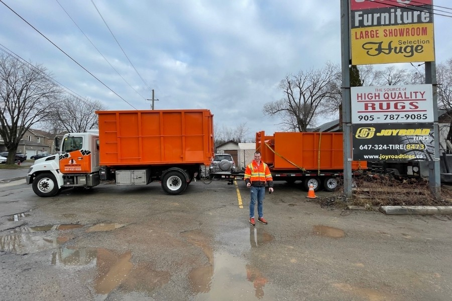 Image depicts our tri-axle trucks delivering a rental bin