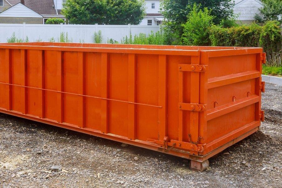 empty orange rental bin for construction waste